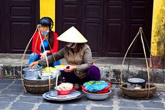 Local Vietnamese women street vendor in Hoi An Stock Photography