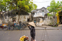 Local Vietnamese women street vendor in Hoi An Vietnam Royalty Free Stock Photo