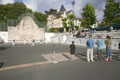 Local villagers in Sare, France, in Basque Country on the Spanish-French border, watch Jai Li game near St. Jean de Luz, on the Co. Te Basque, South West France royalty free stock image