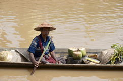 Local waits in boat at the market inla lake Royalty Free Stock Image