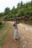 Local Woman Carrying Goods on Head in Chin State, Myanmar Royalty Free Stock Photo