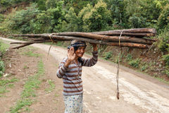 Local Woman Carrying Goods on Head in Chin State, Myanmar Royalty Free Stock Photography
