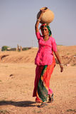 Local woman carrying jar with water on her head, Khichan village Stock Photos