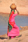 Local woman carrying jar with water on her head, Khichan village Royalty Free Stock Image