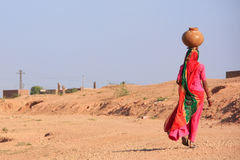 Local woman carrying jar with water on her head, Khichan village Stock Images