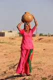 Local woman carrying jar with water on her head, Khichan village Royalty Free Stock Photo