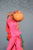 Local woman carrying jar with water, Khichan village, India Royalty Free Stock Image