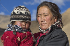 Local woman with a child on the street in Leh, Ladakh, India Royalty Free Stock Images