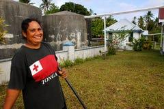 Local woman cleaning church yard, Ofu island, Tonga Stock Photos