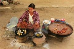 Local woman cooking in the street of Mingun, Mandalay, Myanmar Royalty Free Stock Photos