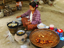 Local woman cooking in the street of Mingun, Mandalay, Myanmar Stock Photography