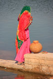 Local woman getting water from reservoir, Khichan village, India Royalty Free Stock Photography