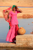 Local woman getting water from reservoir, Khichan village, India Stock Photos