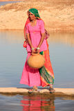 Local woman getting water from reservoir, Khichan village, India Royalty Free Stock Photo