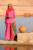 Local woman getting water from reservoir, Khichan village, India Stock Image