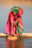 Local woman getting water from reservoir, Khichan village, India Royalty Free Stock Images