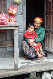 Local Woman holding Child in Chin State, Myanmar Royalty Free Stock Photo