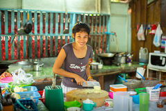 Local woman on the kitchen. The island is part of marine national Park Mu Ko Chang. KO CHANG - THAILAND - DEC 19, 2015: Unidentified local woman on the kitchen Royalty Free Stock Photo