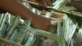 Local woman making a nipa palm roof panel, Myanmar
