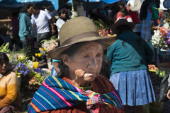 Local woman in a market in the city of Pisac, in the Sacred Valley. Stock Photos