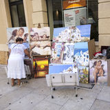 Local woman offers paintings to tourists Royalty Free Stock Photo