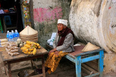 Local woman selling food in the street of Mingun, Mandalay, Myan Royalty Free Stock Photo