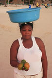 Local woman selling fruits at Boca Chica beach Royalty Free Stock Photos