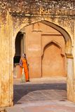 Local woman standing in the fourth courtyard of Amber Fort, Raja Stock Photography