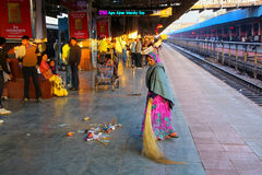 Local woman sweeping at Jaipur Junction railway station in Rajas Royalty Free Stock Image