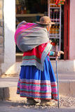Local woman walking in the street of Chivay town, Peru Stock Photos
