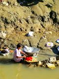 Local woman washing clothes in Ayeyarwady river, Mandalay, Myanm. Ar. Ayeyarwady river is the largest river in Myanmar Royalty Free Stock Image