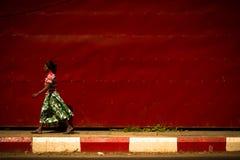 A Local Woman of Yangon, Myanmar walking Royalty Free Stock Photos