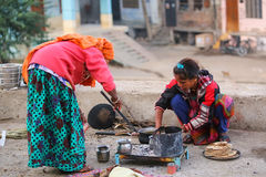Local women cooking chapati in the street of Jaipur, Rajasthan, Royalty Free Stock Photos