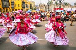 Local women dancing during Festival of the Virgin de la Candelar Stock Photo
