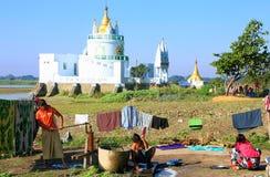 Local women doing laundry near Buddhist temple, Amarapura, Myanm Stock Image