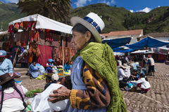 Local women in a market in the city of Pisac, in the Sacred Valley. Pisac, Peru - December, 2013: Local women in a market in the city of Pisac, in the Sacred Stock Images