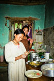 Local women prepare Tibetan dishes in the kitchen of a local res Royalty Free Stock Images
