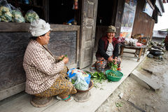 Local Women Preparing Vegetables in Chin State, Myanmar Stock Photo