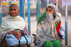 Local women sitting at the train station in Agra, Uttar Pradesh,. India. Agra is one of the most populous cities in Uttar Pradesh Stock Image