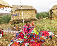 Local women in traditional attire work sell handicrafts Stock Photos