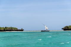 Local wooden boat sailing the Indian Ocean, Tanzania Royalty Free Stock Photo