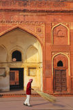 Local worker sweeping courtyard of Jahangiri Mahal in Agra Fort, Stock Images