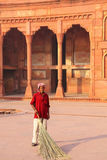 Local worker sweeping courtyard of Jahangiri Mahal in Agra Fort, Stock Photos