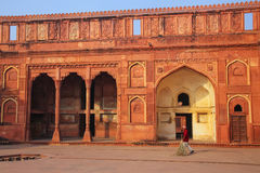 Local worker sweeping courtyard of Jahangiri Mahal in Agra Fort, Royalty Free Stock Photography