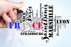 Localities in France word cloud travel concept. Over human hand background royalty free stock photo