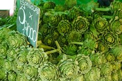 Locally-grown artichokes in a vegetable stall in Valparaiso's old grocery market, Chile