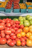 fresh picked tomatoes on table outside at farmers market royalty free stock image