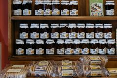 Locally made marmalade and biscuits for sale in Lacock, UK. Locally made marmalade and biscuits for sale in Lacock, a small village and civil parish in the royalty free stock photography