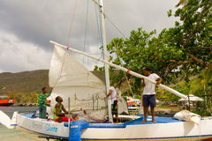 A locally made traditional sailboat being rigged for a regatta Stock Image