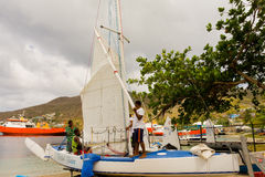 A locally made traditional sailboat being rigged for a regatta Stock Photos